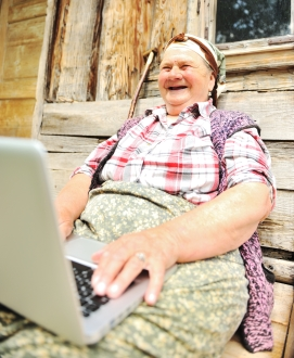 Senior aged woman with laptop
