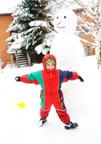 Children on snow with snowman