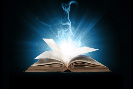 Glowing book with blue lights on black background.