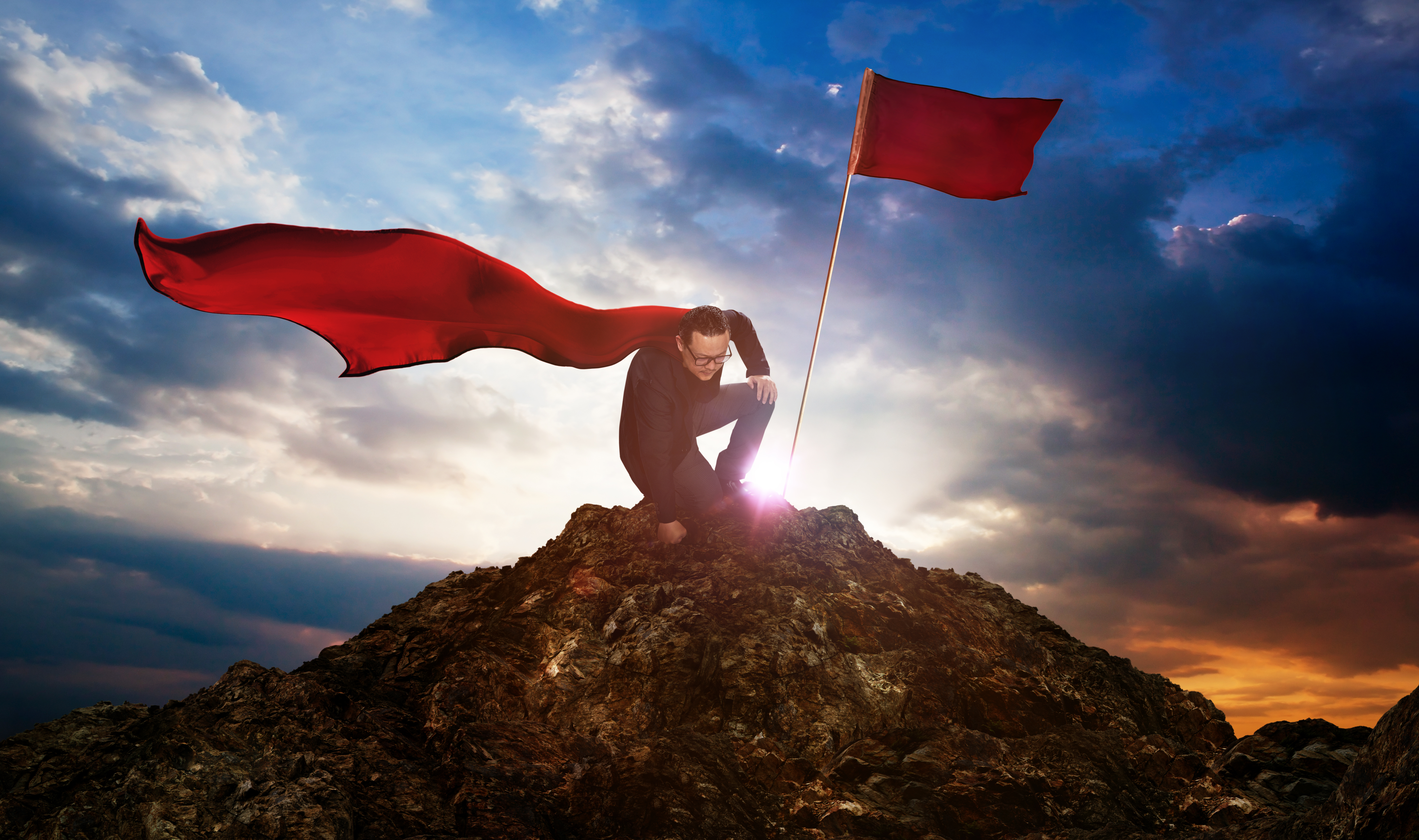 graphicstock-businessman-in-a-suit-and-cape-hero-on-top-of-a-mountainbusiness-success-concept_SuUs6oPejg