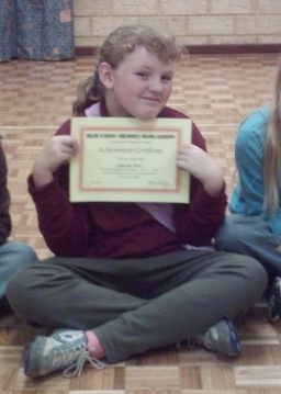 050630 0023 Catty sitting displaying her certificate crop.jpg