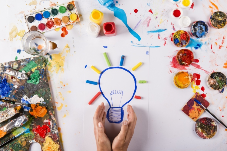 Graphicstock-creative-idea-concept-with-colorful-paints-over-white-paper crop