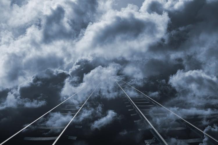 lonely-train-track-stretching-into-horizon_rKcs9ECEi