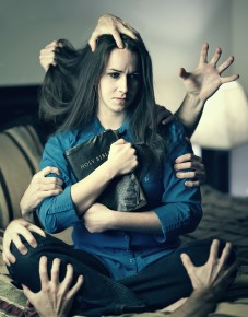 a-woman-holds-her-bible-as-many-hands-grab-her_BQzKGyzeA