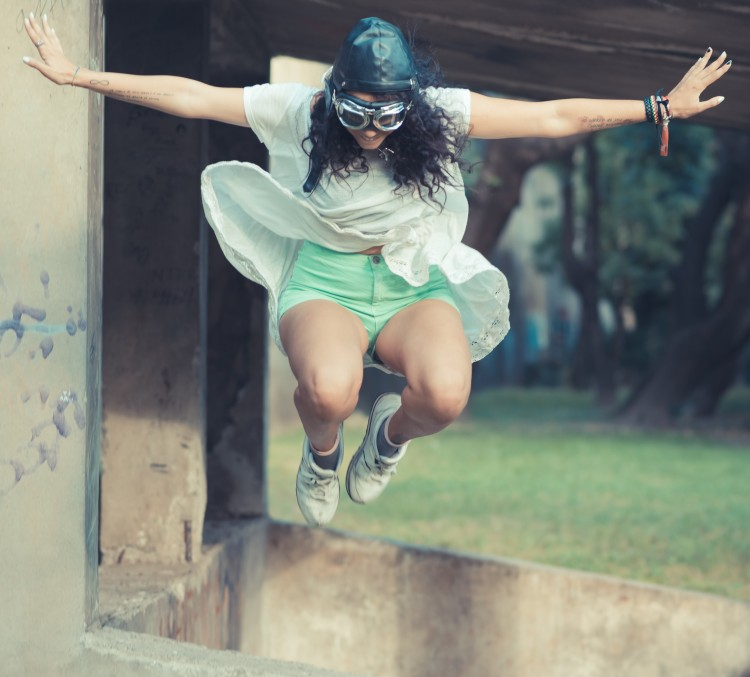 graphicstock-aviator-funny-young-beautiful-moroccan-curly-woman-at-the-park_Ba3LhxoJZ crop