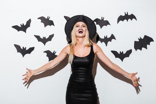 graphicstock-beautiful-blonde-young-woman-in-witch-costume-standing-and-laughing-over-white-background_Sdz0x0jH2g