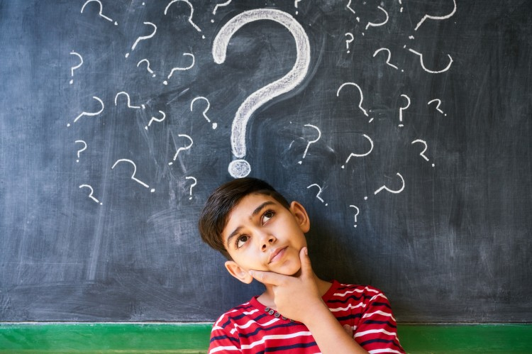 graphicstock-concepts-on-blackboard-at-school-hispanic-boy-with-doubts-and-thoughts-in-class-portrait-of-male-child-thinking-against-question-marks-on-blackboard_rsE7soPDZ