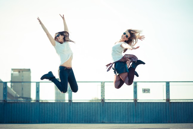 graphicstock-two-beautiful-young-women-jumping-and-dancing-in-the-city_HgltTB4-xb
