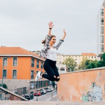 graphicstock-young-handsome-caucasian-redhead-straight-hair-woman-jumping-outdoor-in-the-city-hands-up-laughing-girl-power-goal-success-concept_SpeSIshOkb