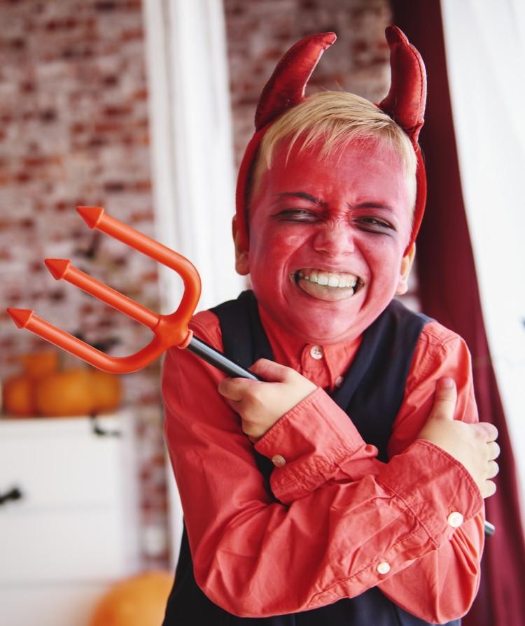 storyblocks-boy-in-devil-costume-grimacing_BvZmY4WKqz