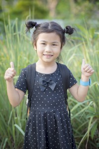 storyblocks-face-of-asian-children-smiling-face-and-sign-good-feeling-by-finger_HOX7x3ncz (1)