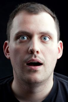 a-shocked-or-surprised-middle-aged-man-over-a-dark-background_SF1M4NvCro