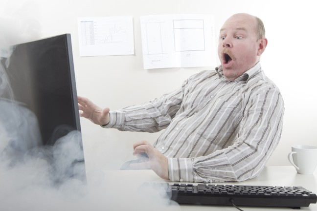 graphicstock-office-worker-businessman-with-computer-problems-or-very-fast-internet-computer-smoke-coming-from-the-computer-screen_HdzlDuoMsl