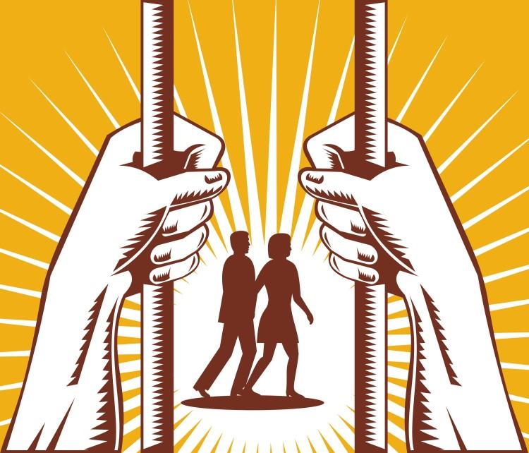 hands-on-prison-bars-with-figures-walking_zJpnuwUu_L