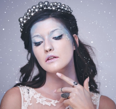 storyblocks-front-view-of-woman-in-frosty-make-up-among-snow-falling_Bvd69gF5M